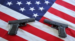 Two Glock .40 caliber semiautomatic handguns are displayed in Woodbury, Minnesota on May 28, 2011. AFP PHOTO/Karen BLEIER (Photo credit should read KAREN BLEIER/AFP/Getty Images)